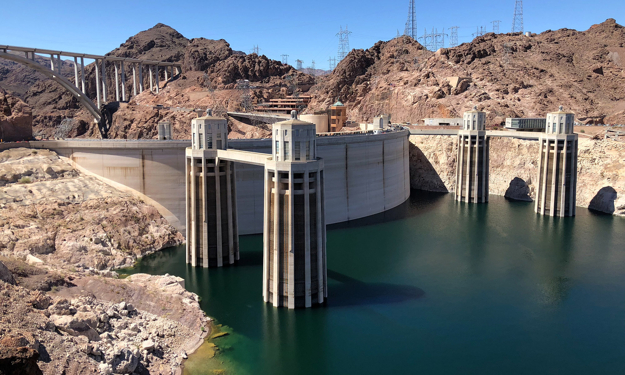 Hoover Dam's Penstock towers take in water from Lake Mead and use it to generate electricity. With less water, the dam generates less electricity, so officials replaced some of the dam's turbines to increase efficiency. (Photo by Jordan Evans/Cronkite News)